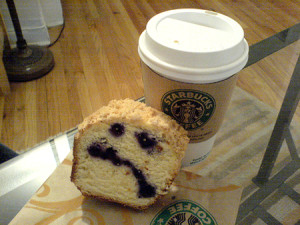 Starbucks coffee cup and an unhappy cake
